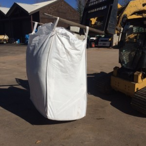 1-ton of compressed leaves taken from 3/4 of an acre or 33,774 square feet.